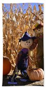 Two Cute Scarecrows With Pumpkins In The Dry Corn Field Bath Towel