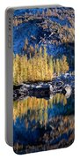 Larch Tree Reflection In Leprechaun Lake Portable Battery Charger