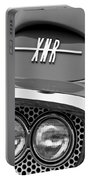1960 Plymouth Xnr Ghia Roadster Grille Emblem Portable Battery Charger by Jill Reger
