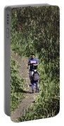2 Photographers Walking Through Tall Grass Portable Battery Charger