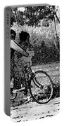 3 Young Children On A Cycle At The Side Of The Road Portable Battery Charger