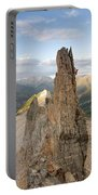 A Man Tops Out A Spire On Treasure Portable Battery Charger