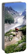 A Man Trail Runs In Chamonix, France Portable Battery Charger