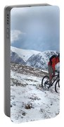 A Mountain Biker Rides Through The Snow Portable Battery Charger