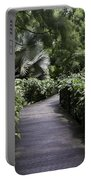 A Raised Walking Path Inside The National Orchid Garden In Singapore Portable Battery Charger