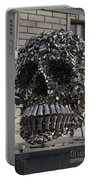 A Skull Sculpture Made Of Cans And Metal Along The Grand Canal Portable Battery Charger