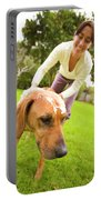 A Woman Gives Her Rhodesian Ridgeback Portable Battery Charger