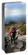 An Athletic Female Hiker Hikes Portable Battery Charger
