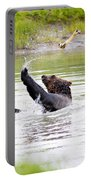Brown Bear Playing With A Bone Portable Battery Charger