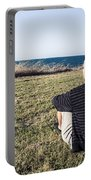 Caucasian Traveler Relaxing On Grass Outdoors Portable Battery Charger