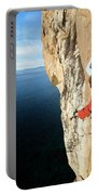 Climber Grabs A Hold While Climbing Portable Battery Charger