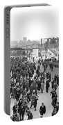 Fans Leaving Yankee Stadium. Portable Battery Charger