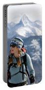Female Backcountry Skier Skinning Portable Battery Charger