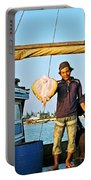 Fisherman With A Skate On Thu Bon River In Hoi An-vietnam  Portable Battery Charger
