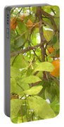 Green Leaves And Mature Oranges On The Tree Portable Battery Charger