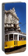 Lisbon's Typical Yellow Tram In Commerce Square Portable Battery Charger
