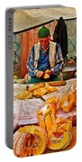 Man Peeling Squash In Antalya Street Market-turkey Portable Battery Charger
