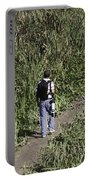 Man With A Canon Camera And Lens In Greenery Portable Battery Charger
