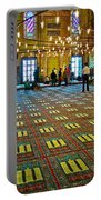 Men Inside The Blue Mosque In Istanbul-turkey Portable Battery Charger