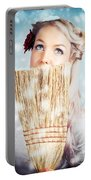 Pin-up Woman Cleaning Up In Cold Blue Winter Snow Portable Battery Charger