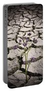 Plant Growing Through Dirt Crack During Drought   Portable Battery Charger