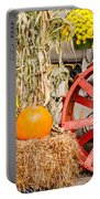 Pumpkins Next To An Old Farm Tractor Portable Battery Charger