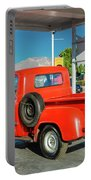 Red Dodge Pickup Truck Parked In Front Portable Battery Charger