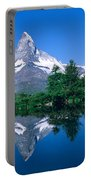 Reflection Of A Snow Covered Mountain Portable Battery Charger