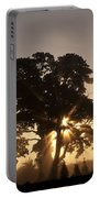 Silhouetted Tree With Sun Rays Portable Battery Charger