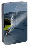 Skier Jumping On A Sunny Day Portable Battery Charger