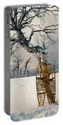 Snowshoes Leaning Against Birch Tree Snowscape Portable Battery Charger
