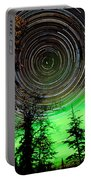 Star Trails And Northern Lights In Sky Over Taiga Portable Battery Charger