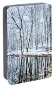 Tree Line Reflections In Lake During Winter Snow Storm Portable Battery Charger