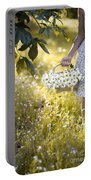 Woman Picking Flowers In A Wild Flower Meadow Portable Battery Charger
