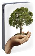 Womans Hands Holding Soil With A Tree Portable Battery Charger