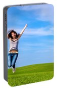 Young Beautiful Woman Jumping For Joy Portable Battery Charger
