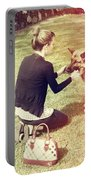 Young Woman In 20s Playing Fetch With Her Dog Portable Battery Charger