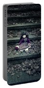 Old Doll Portable Battery Charger by Joana Kruse
