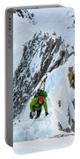 A Man Alpine Climbing A Ridgeline Portable Battery Charger