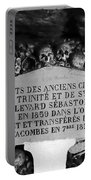 A Marker With Skulls And Bones In The Catacombs Of Paris France Portable Battery Charger