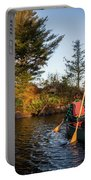 A Young Couple Paddles A Canoe On Long Portable Battery Charger
