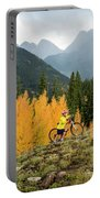 A Young Girl Mountain Biking In The San Portable Battery Charger