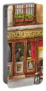 French Storefront 1 Portable Battery Charger by Debbie DeWitt