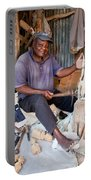 Kenya. December 10th. A Man Carving Figures In Wood. Portable Battery Charger