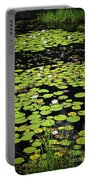 Lily Pads On Dark Water Portable Battery Charger