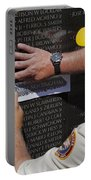 Man Getting A Rubbing Of Fallen Soldier's Name At The Vietnam War Memorial Portable Battery Charger