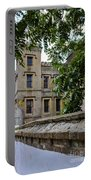 Peek Through The Tree's Of Old City Jail Portable Battery Charger