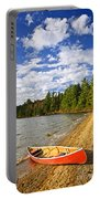 Red Canoe On Lake Shore Portable Battery Charger