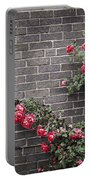 Roses On Brick Wall Portable Battery Charger