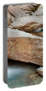 Small Waterfall Casdcading Over Rocks In Blue Pond Portable Battery Charger